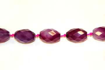 Agate rubi (Shape: Olive faceted of 18x25 mm.)